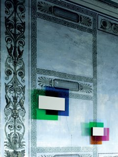 """Color on Color Mirror, for Glas Italia, 2010  In this three-part collection, Grawunder layers color """"like a painter would do,"""" including Rothko-esque """"black-out parts, which is what the mirror does."""" The mirror, at center, is the only part of the fixture that's not colored. """"They wouldn't let me put light in this,"""" Grawunder says, which, ultimately was a good idea. """"The color of the glass itself is so luminous, it almost looks backlit."""""""
