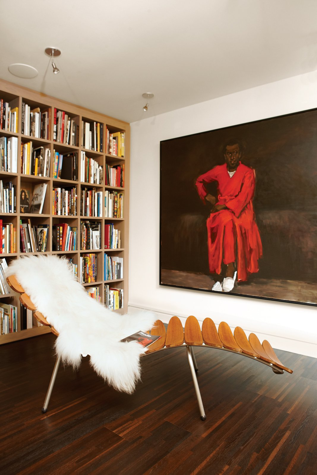 Living Room, Chair, Recliner, and Dark Hardwood Floor Books pepper the apartment, but most are housed in two libraries, one of which is dedicated to art and photography. It also features a Palms lounger by Dutch designer Frans Schrofer and the painting Any Number of Preoccupations by Lynette Yiadom-Boakye.  Best Photos from Party-Friendly Apartment in Toronto