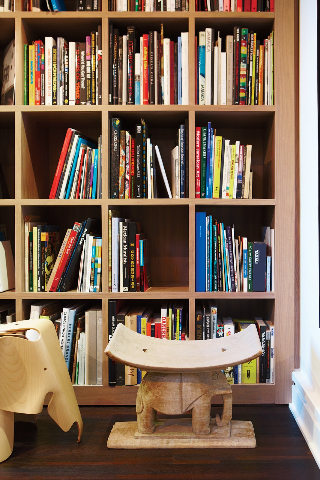 """""""Gatherings here can be a very rich experience, a dis-cussion around art history, music, food, and fashion.""""—Kenneth Montague Tagged: Storage Room and Shelves Storage Type.  Photo 4 of 15 in Party-Friendly Apartment in Toronto"""
