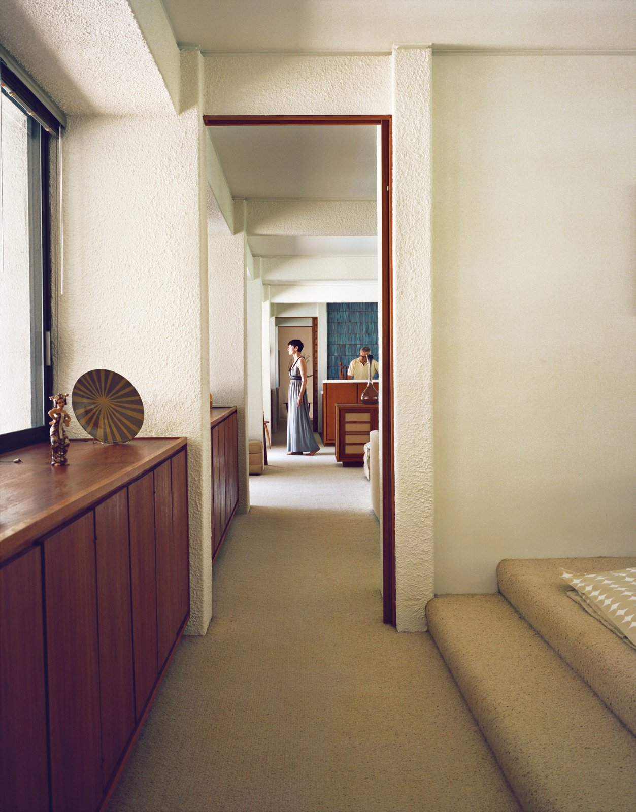 Stacey Chapman Paton stands in the hallway.  Photo 7 of 15 in Modern Home in a California Resort Town