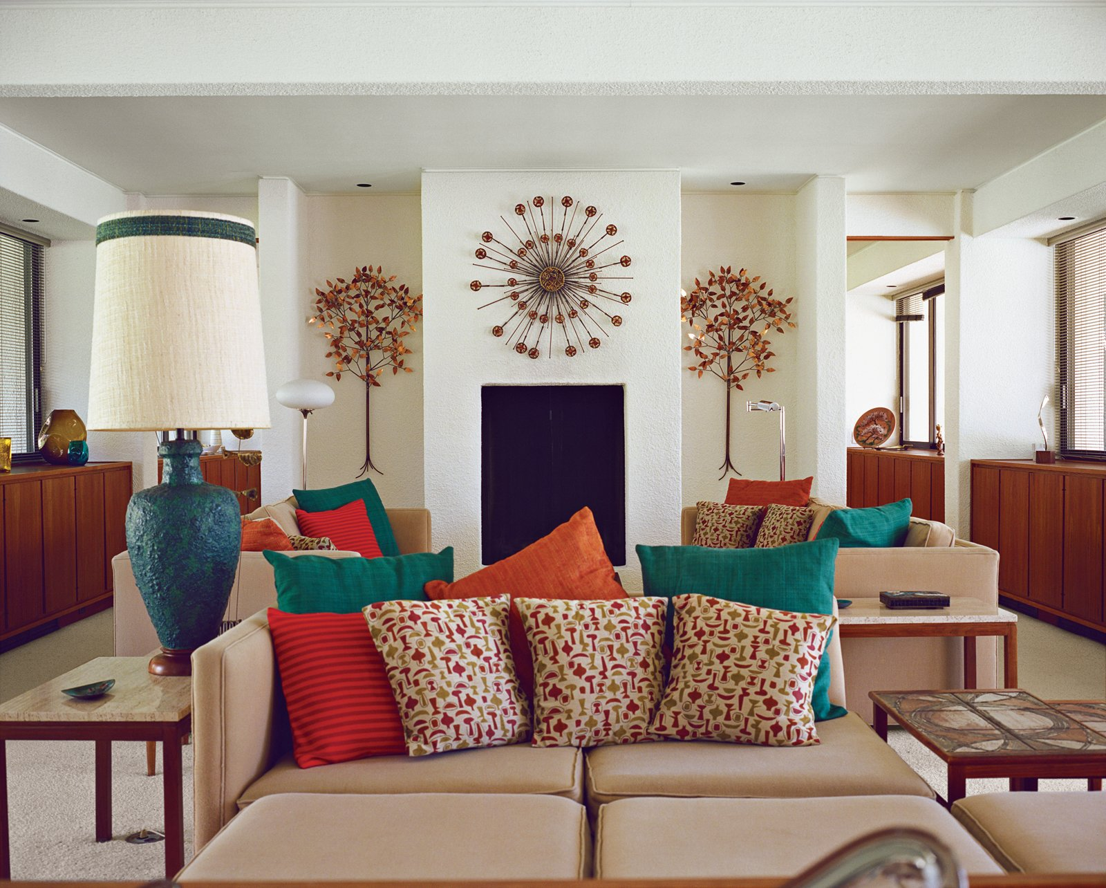 Architect Maurice McKenzie designed not just the home's symmetrical form but the seating in the living room too.  Photo 1 of 15 in Modern Home in a California Resort Town
