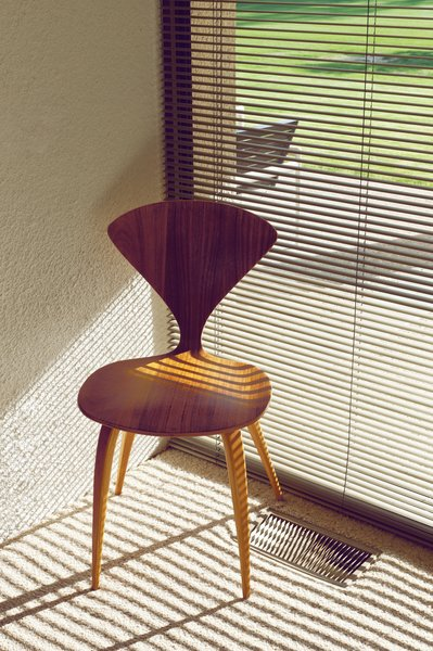 A side chair by Norman Cherner with its back overlooking the golf course.