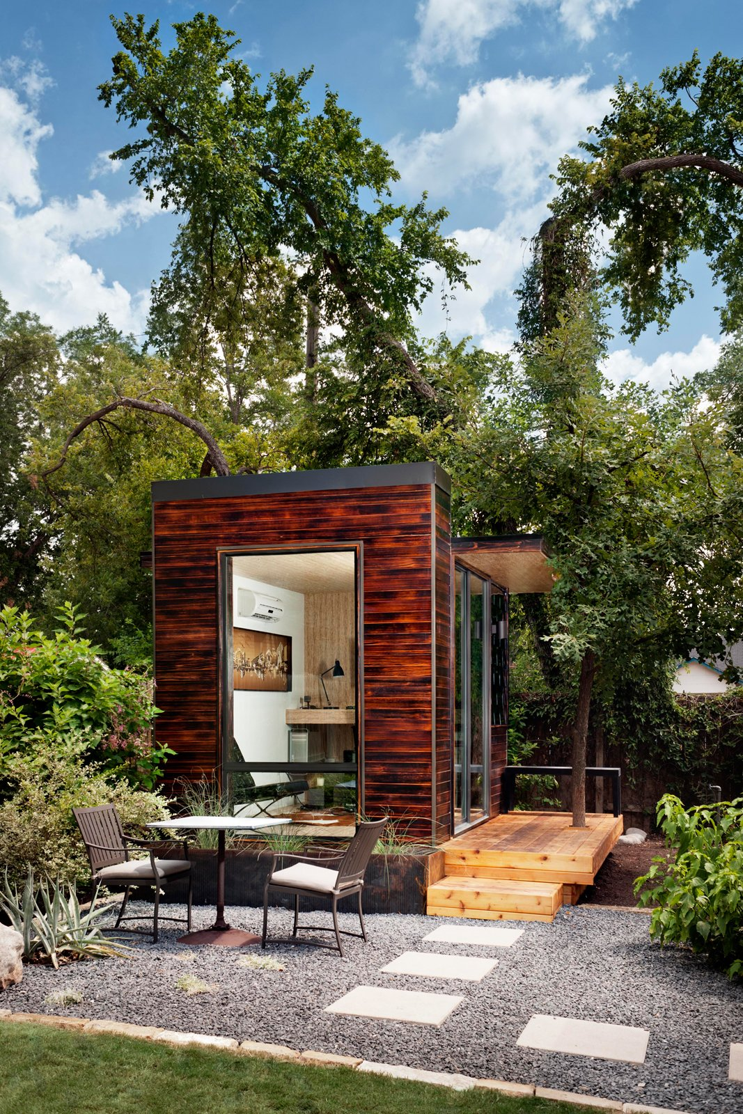 Side Yard, Trees, Shrubs, Small, Hardscapes, Wood, Decking, and Shed & Studio With little to no permitting required, Sett Studio units can be used for an extra bedroom, a yoga studio, a hydroponics growing area or an office space, like this 96-square-foot one shown here.  Best Shed & Studio Hardscapes Trees Photos from On Your Mark, Get Sett