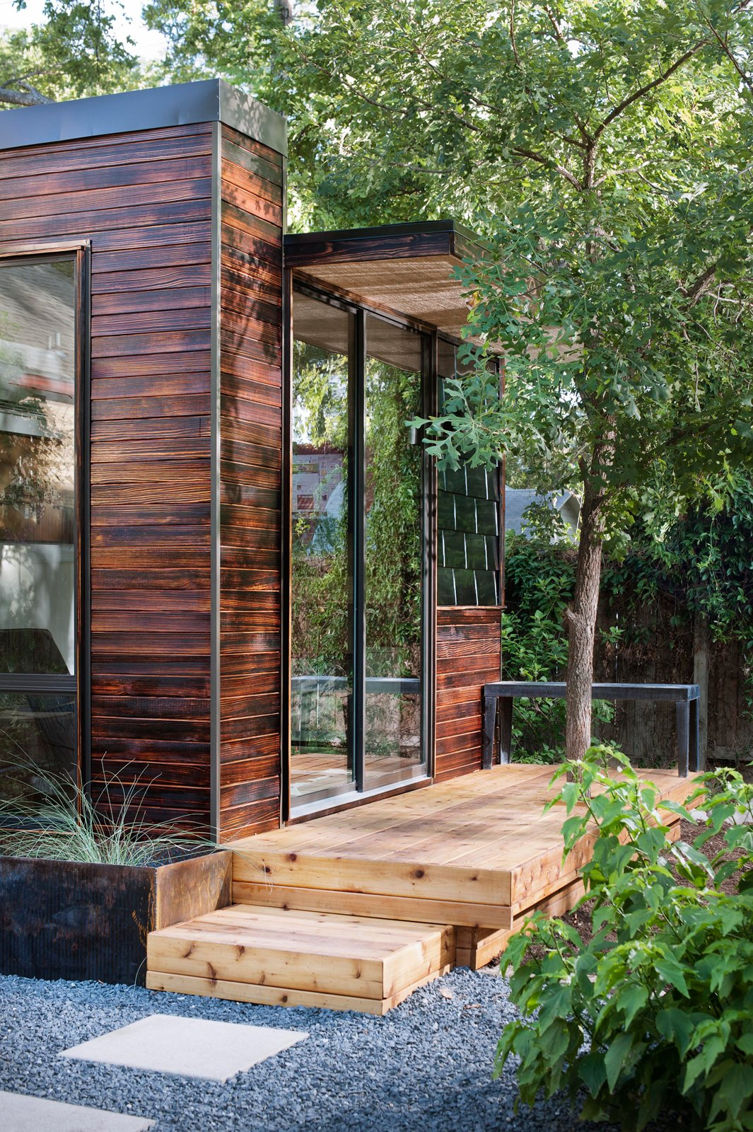 Exterior, House Building Type, and Wood Siding Material In addition to charred wood siding—shown here in the cherry stain—Sett Studio can also add decking and landscaping.  Photo 3 of 13 in On Your Mark, Get Sett