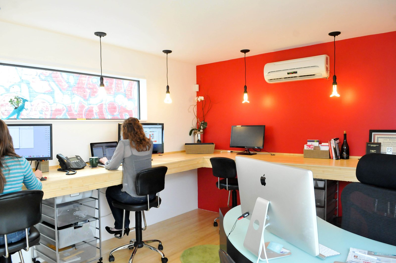 Office and Desk For the realty group interior space, eight people comfortably work in the 12-foot-by-14-foot room. There's a mini slit A/C and heating system, painted sheetrock walls and bamboo floors and desk.  Photo 11 of 13 in On Your Mark, Get Sett
