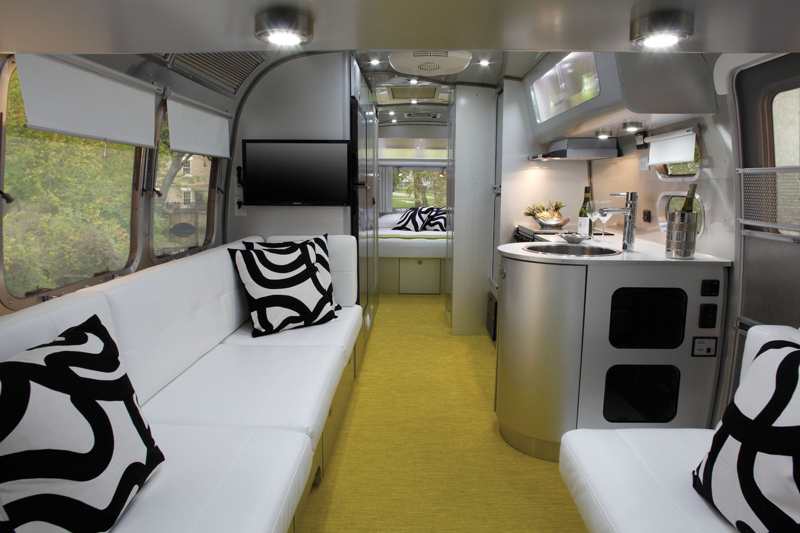 Living Room, Sofa, Carpet Floor, and Ceiling Lighting Architect Christopher C. Deam, Dwell founder Lara Deam's husband, designed Airstream's newest travel trailer, the International Sterling.  Photos from Airstreams We Love