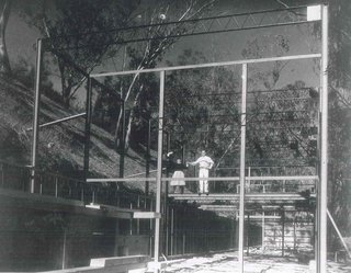 Charles and Ray on the steel frames of their home while it was under construction in 1949.