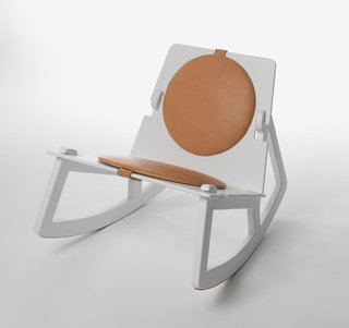 """""""In Rock Chair by Fredrik Färg, four pieces are together to become a low-level rocking chair that is really comfortable. Fredrik become the designer of the year in Sweden last year,"""" says Färdig."""
