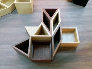 Triangular–, square–, and diamond-shaped wooden boxes have magnets embedded into the sides so that they can join together to create endless geometric patterns that function as a super beautiful desktop organizer. Made by Japanese brand Colors, the MagContainers are available in Walnut, Japanese quince, and Tamo wood.