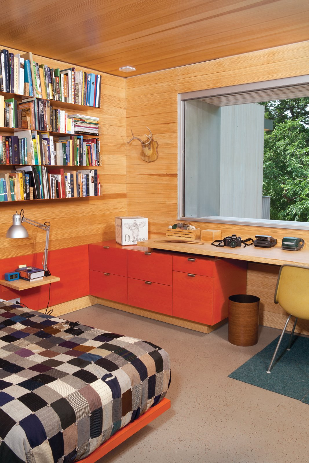 Bedroom, Bed, and Shelves James's bedroom furniture was custom designed by Hatch Workshop.  Photo 1 of 10 in Hillside Mid-Century Home Renovation in Texas