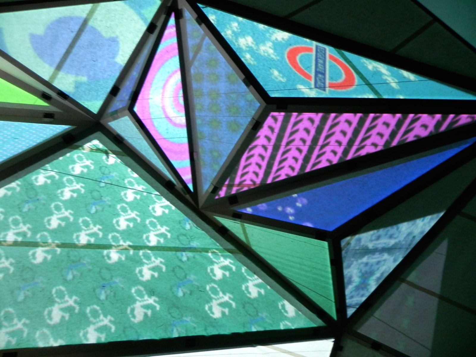 "Before reaching the very top, inside the blacked out dome structure, London-based artist Keiichi Matsuda installed Prism, a giant sculpture installation made from paper. Each one of its 47 colorful facets displayed a projected data stream that communicated information about the city outside. Kiichi explained, ""I can now understand and read the Prism enough to be able to tell you what the conditions are like outside, it's probably fairly windy, there are very few Boris bikes available for hire, which would imply that there's no rain.""  London Design Festival 2012 by Ali Morris"