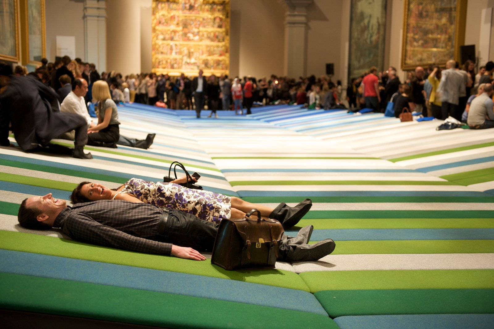 Festival-goers experience Textile Field by Ronan and Erwan Bouroullec, installed in the Rafael Court of the V&A at the London Design Festival 2011. Photo by Susan Smart.  Photo 1 of 4 in The Design Week Movement