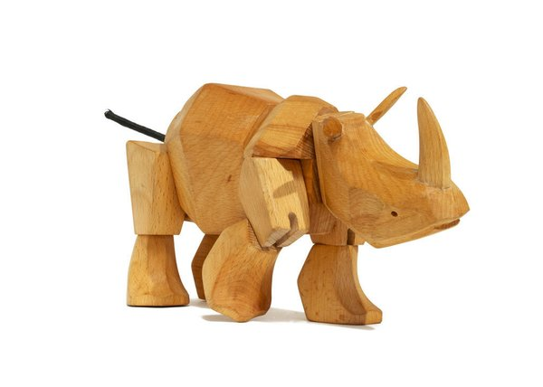 In the wild, the rhinoceros is not to be trifled with; this durable wooden version is a fitting representation of the powerful beast. Crafted from wood and ingeniously bound by hidden elastic bands, Simus is tough enough to withstand even the most boisterous play date.