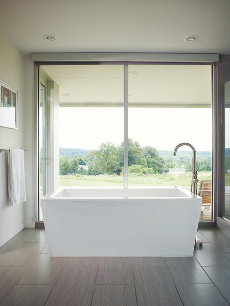 The best view in the house may be from the freestanding   Eaton acrylic bathtub off the master bedroom, which overlooks a neighboring pasture.