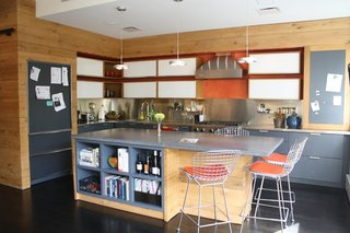 A main goal of the remodel was to open the apartment by raising the ceilings. The owners were surprised with how much space they had to work with. The kitchen blends in seamlessly with the living room on one side and the open terrace on the other.