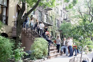 Eager visitors to the Chelsea townhouse designed by architect Julian King queue up outside the residence.