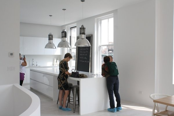 The kitchen features Corian cabinets and countertops.