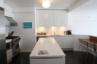 The sleek kitchen looks down on the main living space.