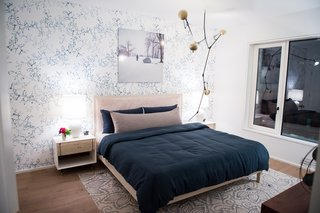 A BDDW furnished bedroom with custom Lindsey Adelman lighting.