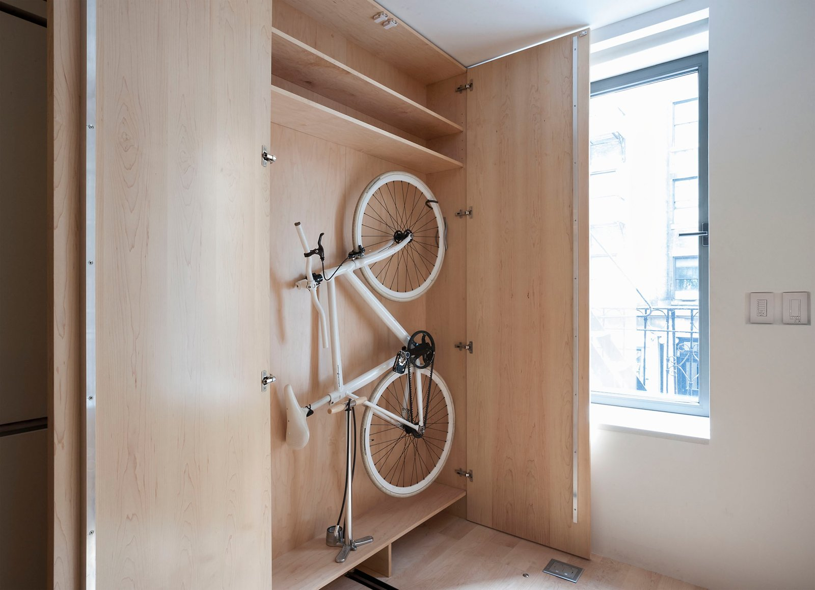 Hill's ThinBike, which he designed in partnership with Schindelhauer, features folding handlebars and pedals that allow it to easily fit snugly against a wall (or in this custom-sized cabinet).  Photo 7 of 12 in Small Space Living by LifeEdited