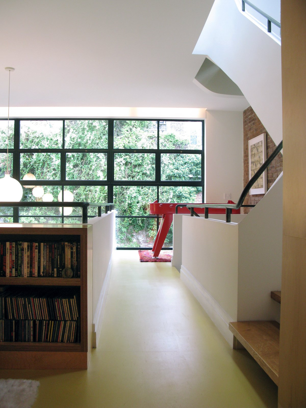 The second floor includes a music and video library, and foosball table.  Photo 4 of 51 in City Modern Home Tours: Brooklyn