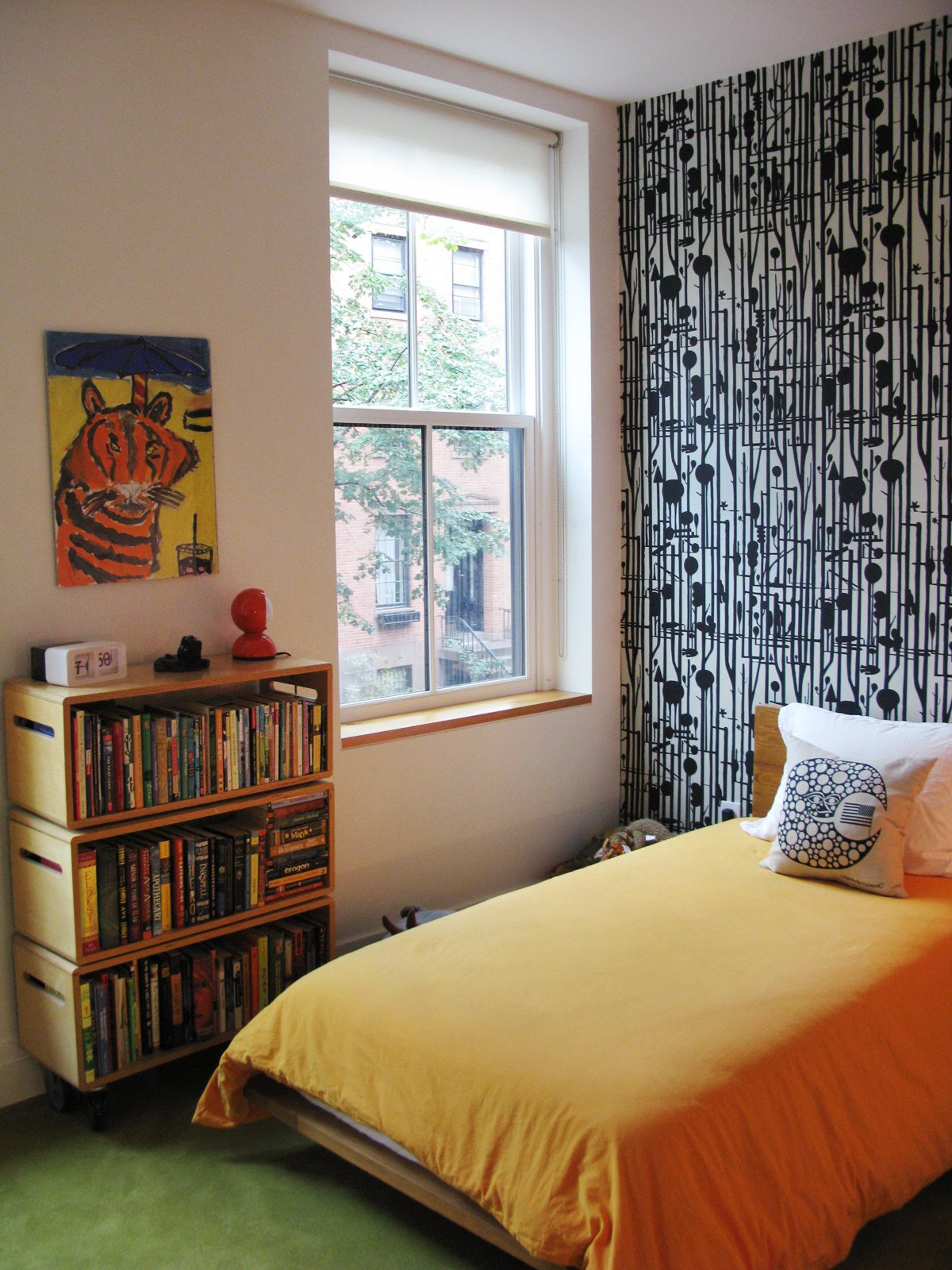 The children's bedroom features bright carpeting and patterned wallpaper.  Photo 26 of 42 in Wallpaper That Fixes Walls