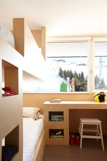 The desk was designed by H2O and has a prime view of the snowy alps.