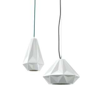 Brian Schmitt slip-cast two pendant light silhouettes—slender and squat—in translucent porcelain. When turned on, each emits a warm glow. The fabric-wrapped cords come in three colors: nougat, teal and grey. Winner of 2012 Dwell on Design Award for Best Lighting.