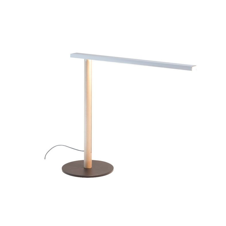 We love this lamp for its brilliant design features, including an etched lens that gently diffuses the light of its LED bulbs for comfortable task work. A single wooden dowel and metal base combine to create a clean and simple modern style statement.  Modern Task Lights by Jaime Gillin from Bright Ideas in Lighting Design