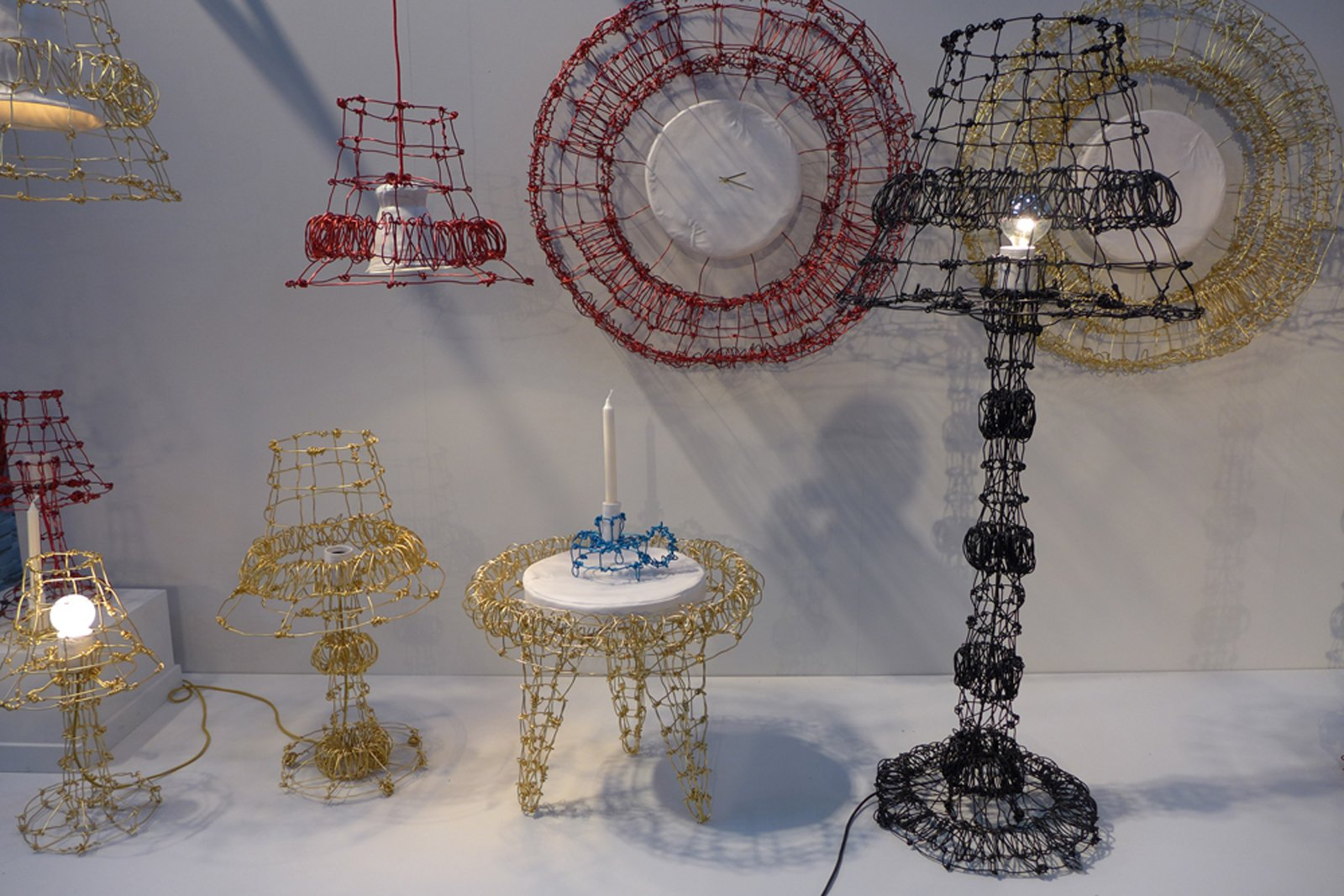 These extravagant pieces by Kiki van Eijk are made from twisted anodized-aluminum wire. They are paired with ceramic pieces molded using fabric templates—a common material element in several of her pieces.  Dutch Design Week 2012, Pt. 2 by Maarten Dinger