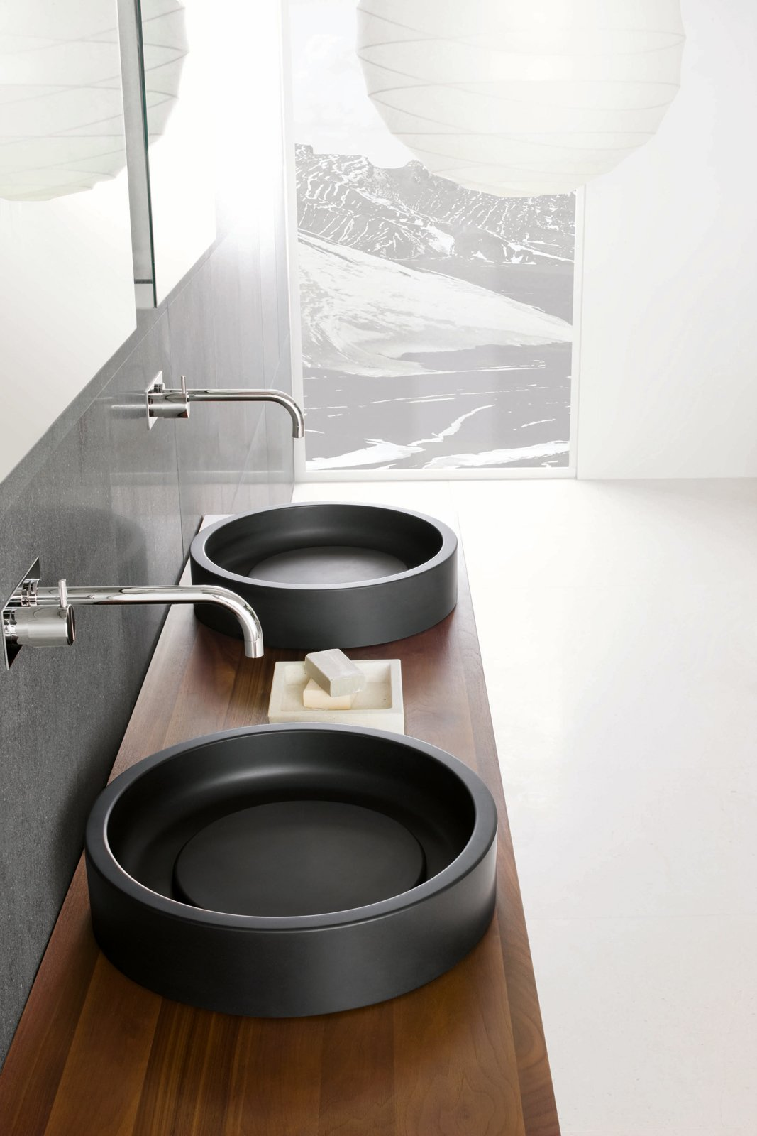 Bath Room, Wood Counter, and Vessel Sink Detail shot of the Inkstone wash-basins in Black Rock stone.  Best Photos from Inky Inspiration