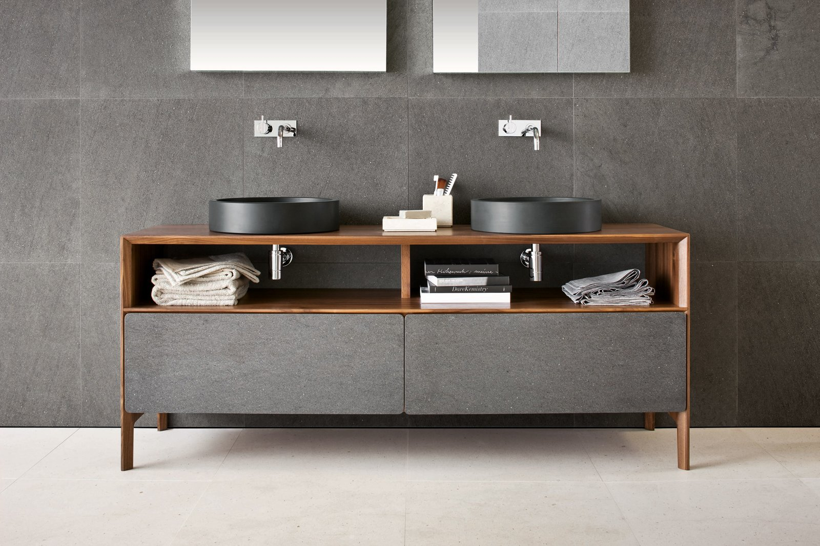 Bath Room, Wood Counter, and Vessel Sink Inkstone wash-basins in Black Rock stone with Neos furniture, made from solid-walnut with Basaltina stone fronts (Neos furniture designed by Luca Martorano).  Best Photos from Inky Inspiration