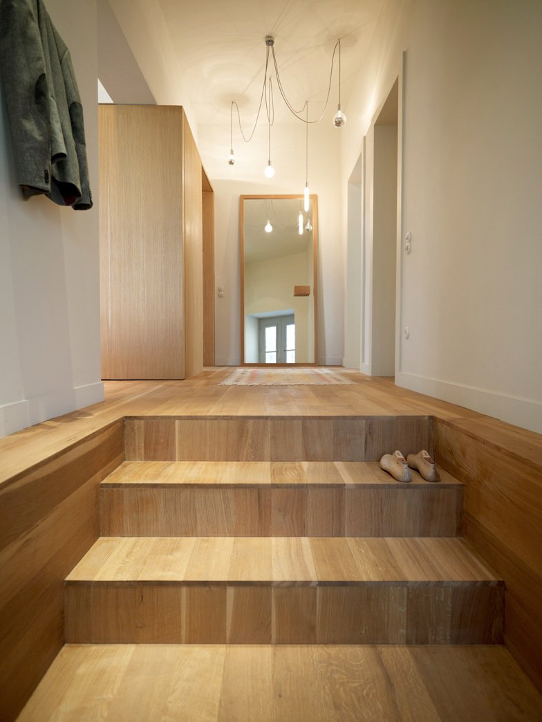 """Staircase and Wood Tread A stairway of white oak, oiled to impart a matte finish, leads into the apartment. The residents left the design decisions up to K-Studio, only requesting that the house have a """"contemporary and calm"""" feeling.  Photo 7 of 20 in How to Recognize Different Wood Species: A Guide to the 10 Most Common Types from More Modern on the Inside: Slab Apartment, Athens"""