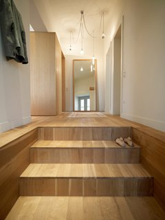 "A stairway of white oak, oiled to impart a matte finish, leads into the apartment. The residents left the design decisions up to K-Studio, only requesting that the house have a ""contemporary and calm"" feeling."