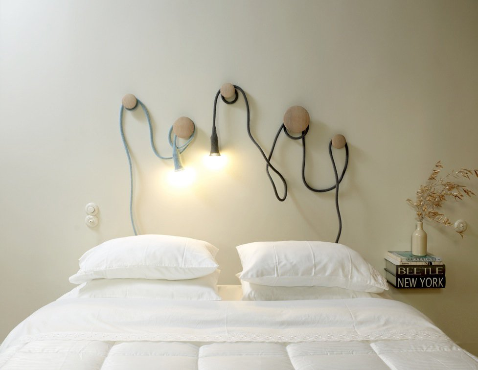 Two of Llot Llov's Matt pendants snake around Muuto wall hooks to provide bedside lighting.  More Modern on the Inside: Slab Apartment, Athens by Diana Budds