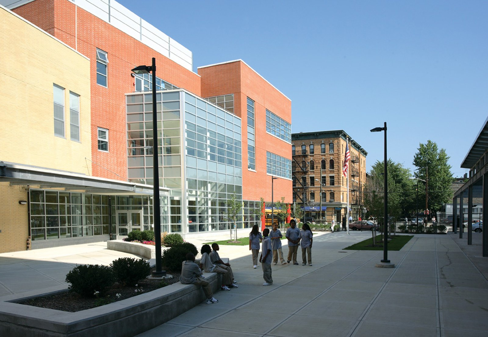 """The urban space is an inspiration for how buildings can facilitate interaction. One example is the Frank R. Conwell School Campus in Jersey City, New Jersey, by Gruzen Samton and IBI Group. """"Over and over you see that the connection to the street is important, whether it's a collection of buildings or a single building it's conceived of in an urban way,"""" Mellins says. """"This open area becomes like a main street that you can look across and see what's happening."""" This allows for both easy planning of events and chance encounters. Photo by James D'Addio.  Photo 7 of 16 in Edgeless School: Design for Learning"""