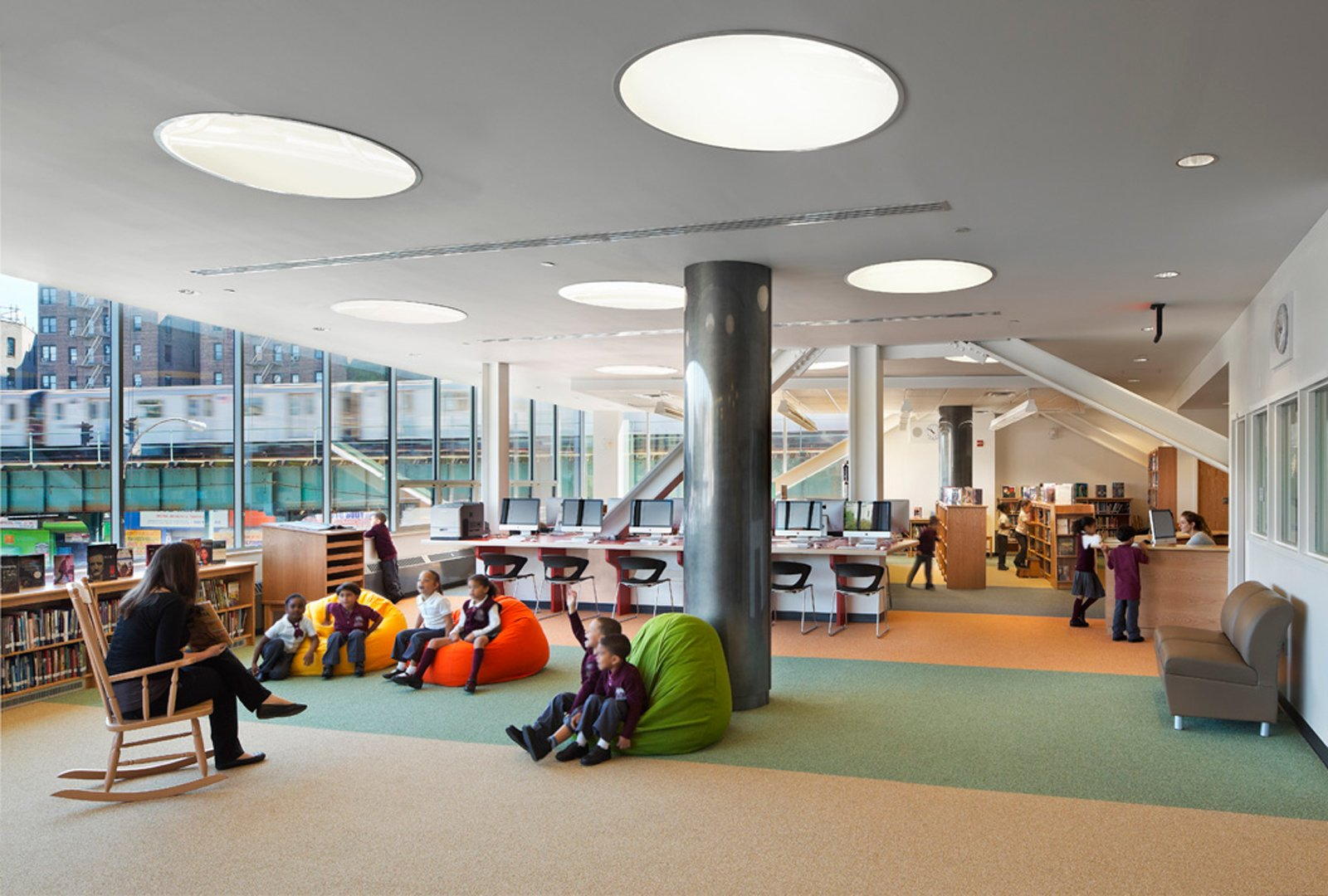 Schools are often large buildings that sit empty while not in use. New Settlement Community Campus in the Bronx is an example of a community benefiting from an educational facility as physical space. The public school is merged with a community center, and its facilities, including an amphitheater, are open to the public after hours.  New Settlement Community Campus was designed by Dattner Architects in association with Edelman Sultan Knox Wood/Architects. Photo by ©David Sundberg/Esto.  Photo 15 of 16 in Edgeless School: Design for Learning