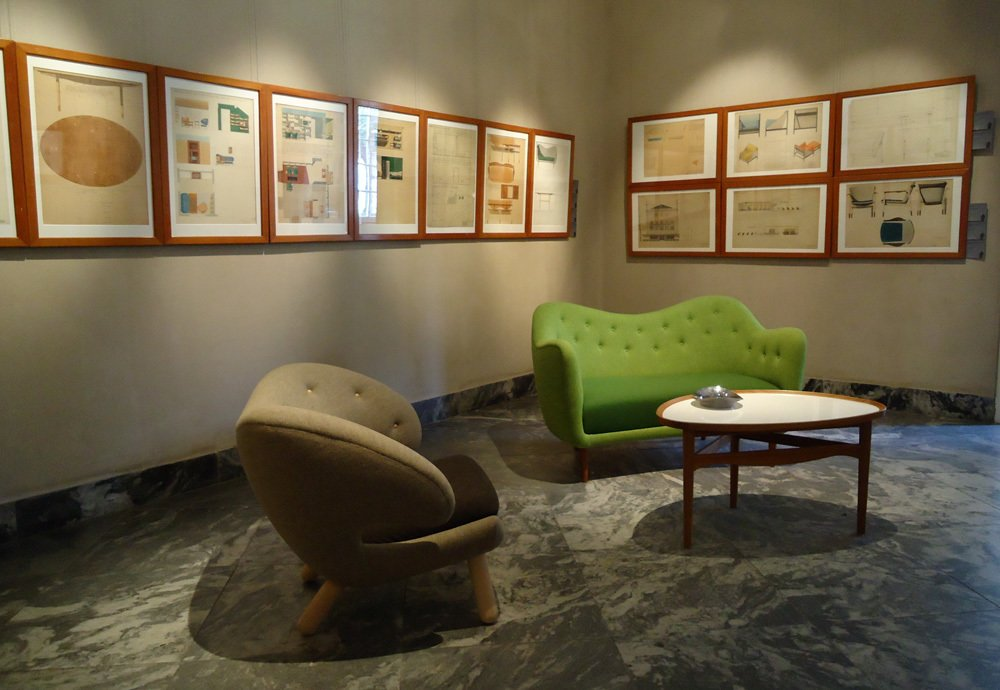 Left, the Pelican double chair, designed in 1940 and still rather outré in terms of its radical silhouette. (Bonus: It's also extremely comfortable, and you can buy a reproduction from OneCollection via Design Within Reach.) Sofa 4600 (right) was designed in 1946 for a small Danish upholstery company called Carl Brørup.  Finn Juhl Centennial at Designmuseum Danmark by Kelsey Keith