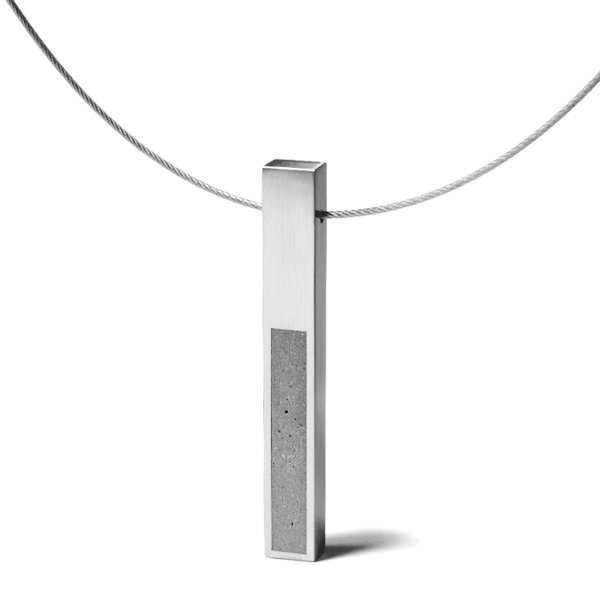 The KMP212 pendant necklacepays homage to Donald Judd's sculptures.  Concrete from The Wearable Architecture of Karen Konzuk