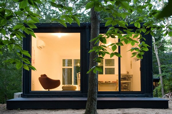Maziar Behrooz designed this container studio set amid lush trees.  Shipping Container from Amazing Examples of Shipping Container Architecture