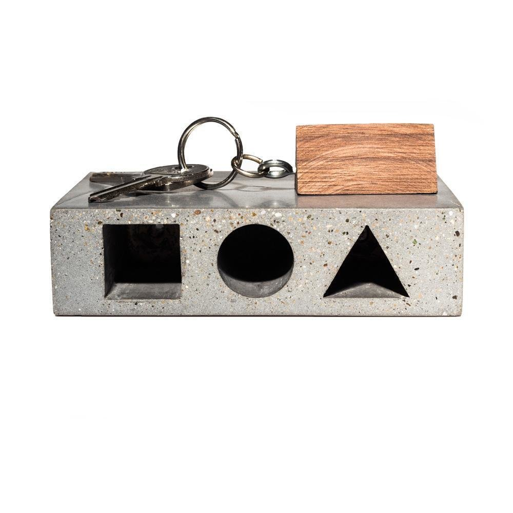Never lose your keys again with the HAUS Key Tresor designed by Studio Ivanka. This concrete box goes on your wall and your keys attach to a shaped block that locks in place according to shape. ($58)  Dwell Holiday Gift Guide: For the One Who's Got It All by Dwell