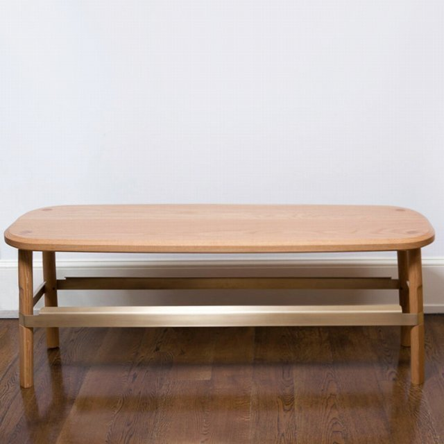 The brass band that wraps around the oak legs of this bench is mighty handsome - just one of the subtle details on this handcrafted bench by of-the-moment designers Rich Brilliant Willing. ($2,220)  Dwell Holiday Gift Guide: For the One Who's Got It All by Dwell