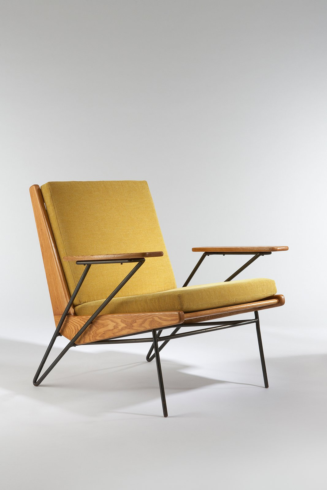 Armchair, 1953. Ash, black enameled metal, upholstered. By Pierre Guariche.  Photo 1 of 10 in Design Miami and Art.sy: Partners in Design from 3 Tips for Mid-Century Modern Collectors