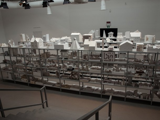 """From the Central Pavilion: """"40,000 Hours"""" is the estimated time that took the students to make this selection of models. It is showcased as a tribute to the collective effort at schools of architecture around the world. Same materials, similar dimensions, and anonymous models for the different projects let us take a look at upcoming ideas and tactics of new architects as well as the state of academic practice through diverse institutions. Finally, special mention deserves MVRDV architects alongside The Why Factory with their 'Freeland' video-installation. It presents a refreshing idea of urban planning in which government agencies are put aside to make way for the self-organizing ability of individuals, which have a lot of freedom but are also responsible for supplying their own needs and grant certain urban values and community services. Will we see the DIY urbanism in the near future? More than images or photos, here are the links to the videos: http://www.youtube.com/watch?v=vMoQCRweXdU http://www.youtube.com/watch?v=NSwtduhoHOU  Search """"Venice"""" from Venice Biennale 2012: Architecture Review"""