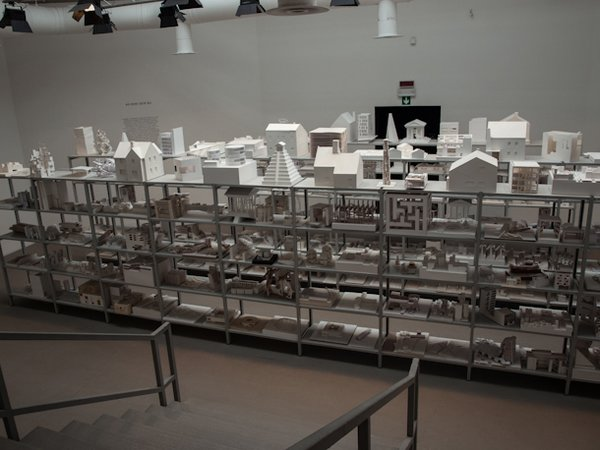 """From the Central Pavilion: """"40,000 Hours"""" is the estimated time that took the students to make this selection of models. It is showcased as a tribute to the collective effort at schools of architecture around the world. Same materials, similar dimensions, and anonymous models for the different projects let us take a look at upcoming ideas and tactics of new architects as well as the state of academic practice through diverse institutions. Finally, special mention deserves MVRDV architects alongside The Why Factory with their 'Freeland' video-installation. It presents a refreshing idea of urban planning in which government agencies are put aside to make way for the self-organizing ability of individuals, which have a lot of freedom but are also responsible for supplying their own needs and grant certain urban values and community services. Will we see the DIY urbanism in the near future? More than images or photos, here are the links to the videos: http://www.youtube.com/watch?v=vMoQCRweXdU http://www.youtube.com/watch?v=NSwtduhoHOU"""