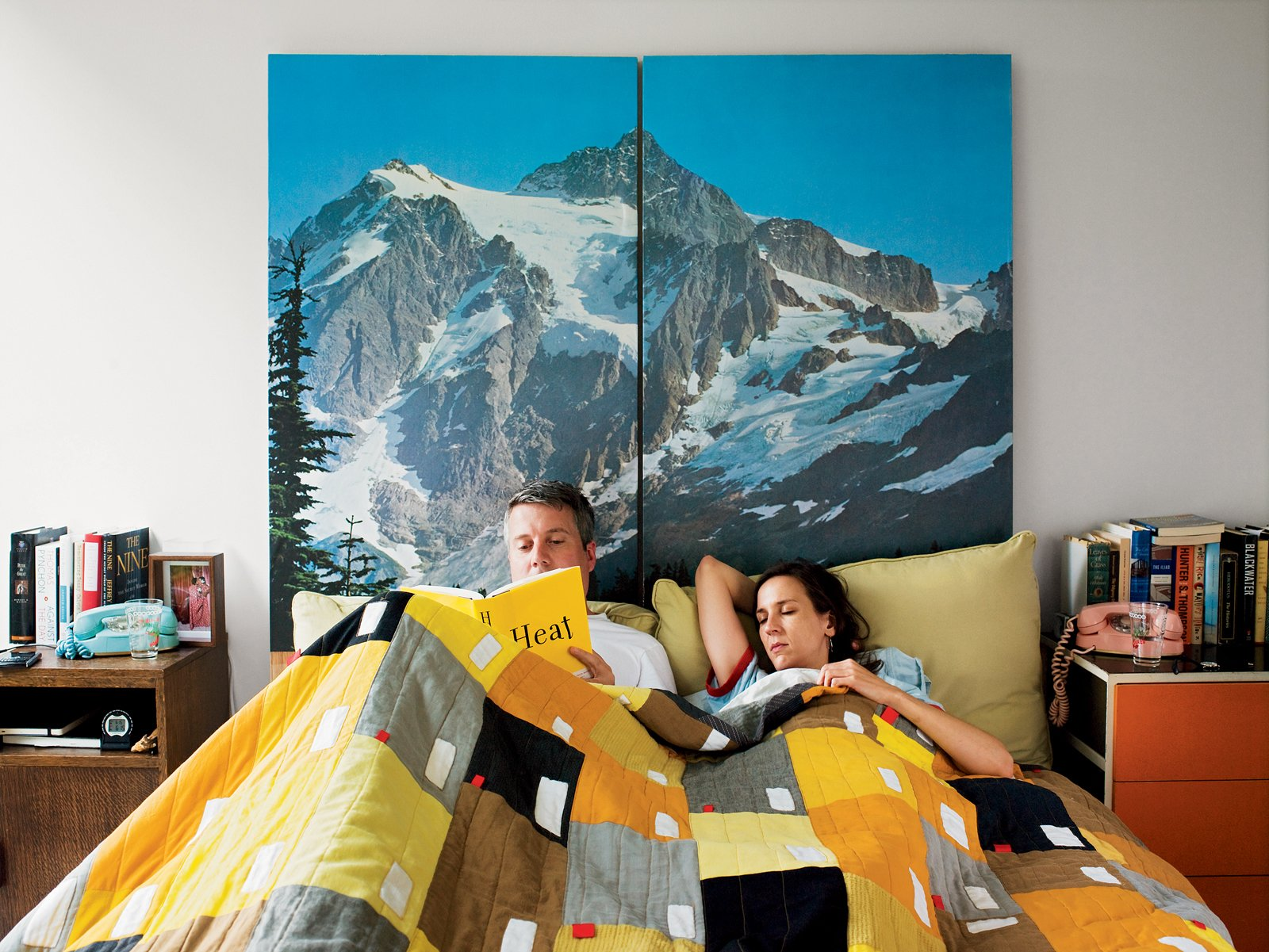 Bedroom, Bed, and Night Stands Toby Barlow and Keira Alexandra enjoy a leisurely Alpine morning in bed in their Detroit high-rise home.  Beautiful Bedrooms by Sara Ost