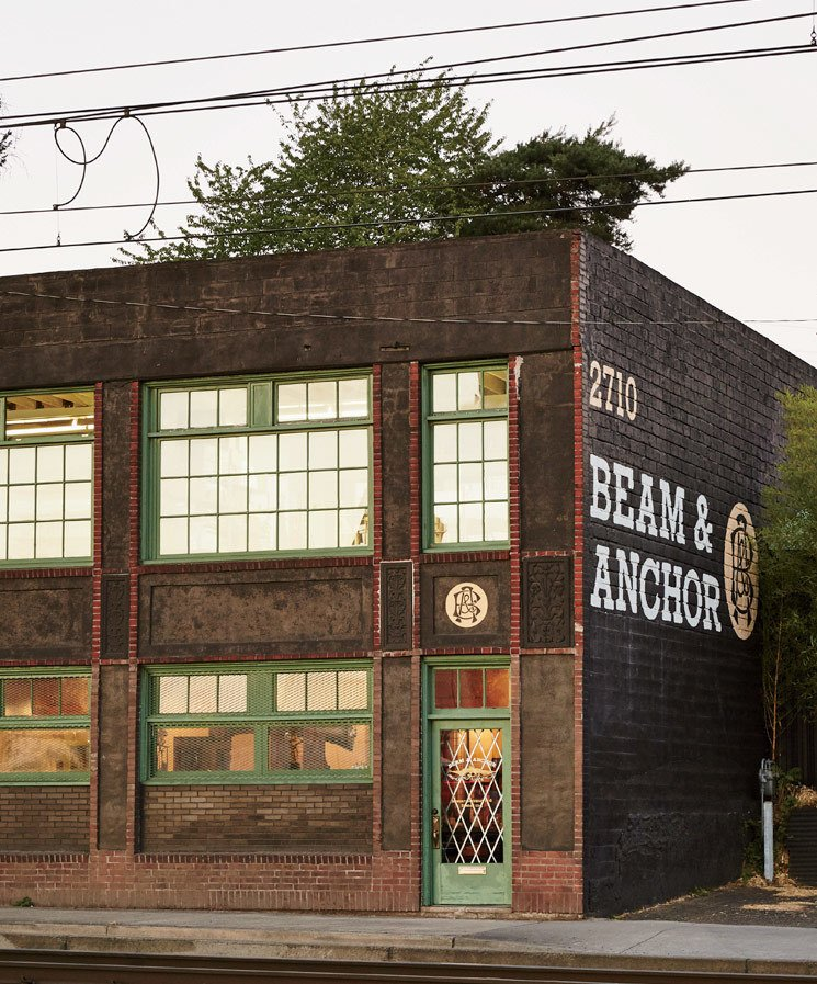 Exterior, Brick Siding Material, and Flat RoofLine Train tracks run adjacent to Beam & Anchor, adding to its romantic charm.  Modern Spaces in the Pacific Northwest by William Lamb from A Portland Store That Hosts Workshops for Local Craftsmen and Makers