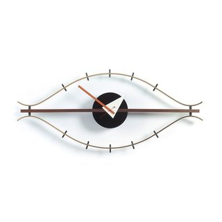 George Nelson worked with Vitra to create a variety of wall clocks, including the Eye Clock, rendered here in luxe brass and rich walnut. Now considered an icon of midcentury design, the Eye Clock is a distinct departure from traditional clocks—it is shaped like an abstract eye, including lash ticks to mark the time instead of a conventionally numbered face.