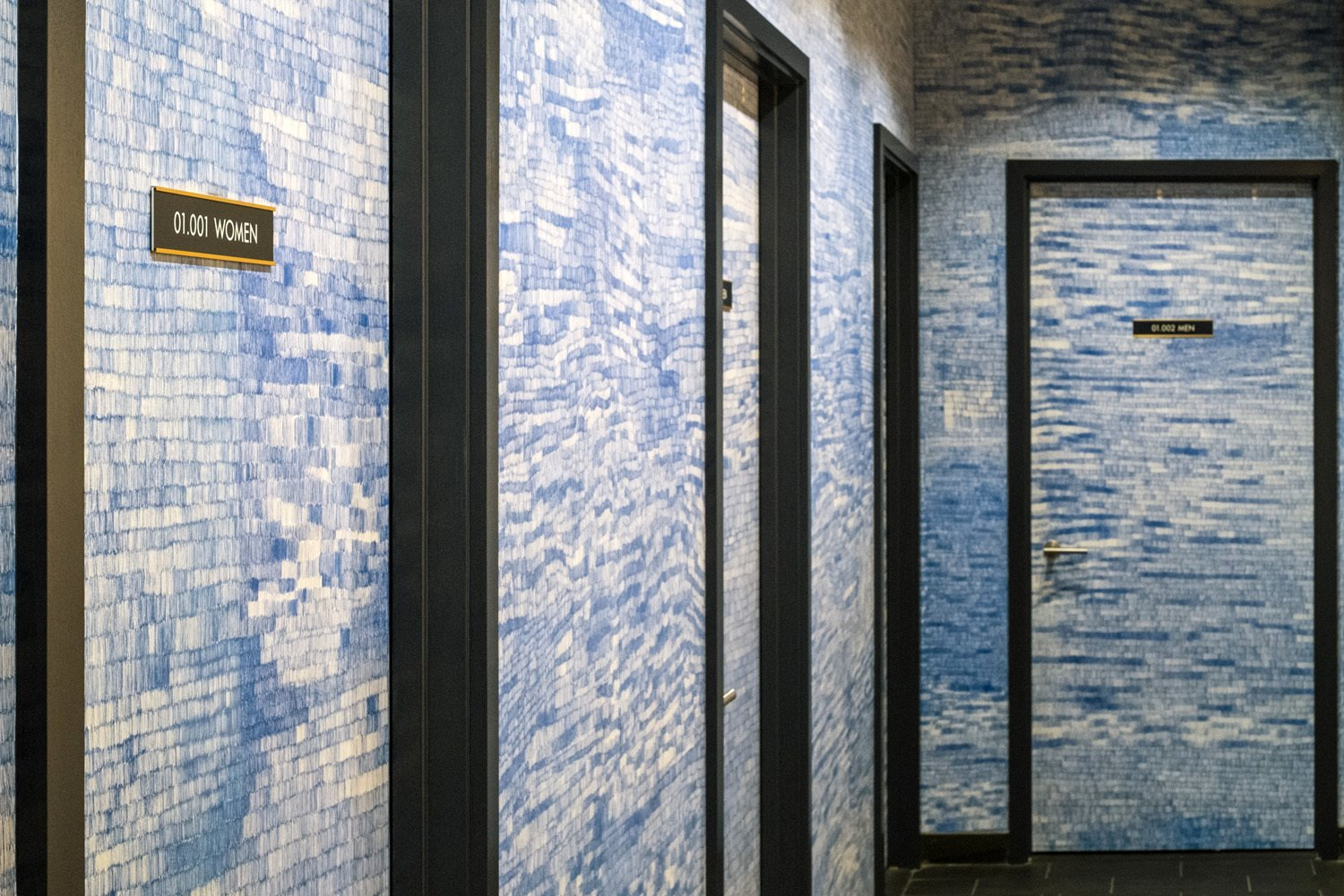 "AvroKO worked with Boka Restaurant Group on Momotaro, the design firm's first-ever project in the Windy City. For a reprieve from the dark woods and polished luster of the dining room, take a break in the blue-and-white tile-lined bathroom area. It pays homage to Japan's history of ceramic production, while at the same time, says partner Kristina O'Neal, ""We were inspired by an era of Japanese history called the Economic Miracle, a period of time right after World War II in which the Japanese embraced a number of western ideas to rebuild their economy.""  Photo 4 of 4 in Head to 1960s Japan via AvroKO-Designed Restaurant in Chicago's West Loop"