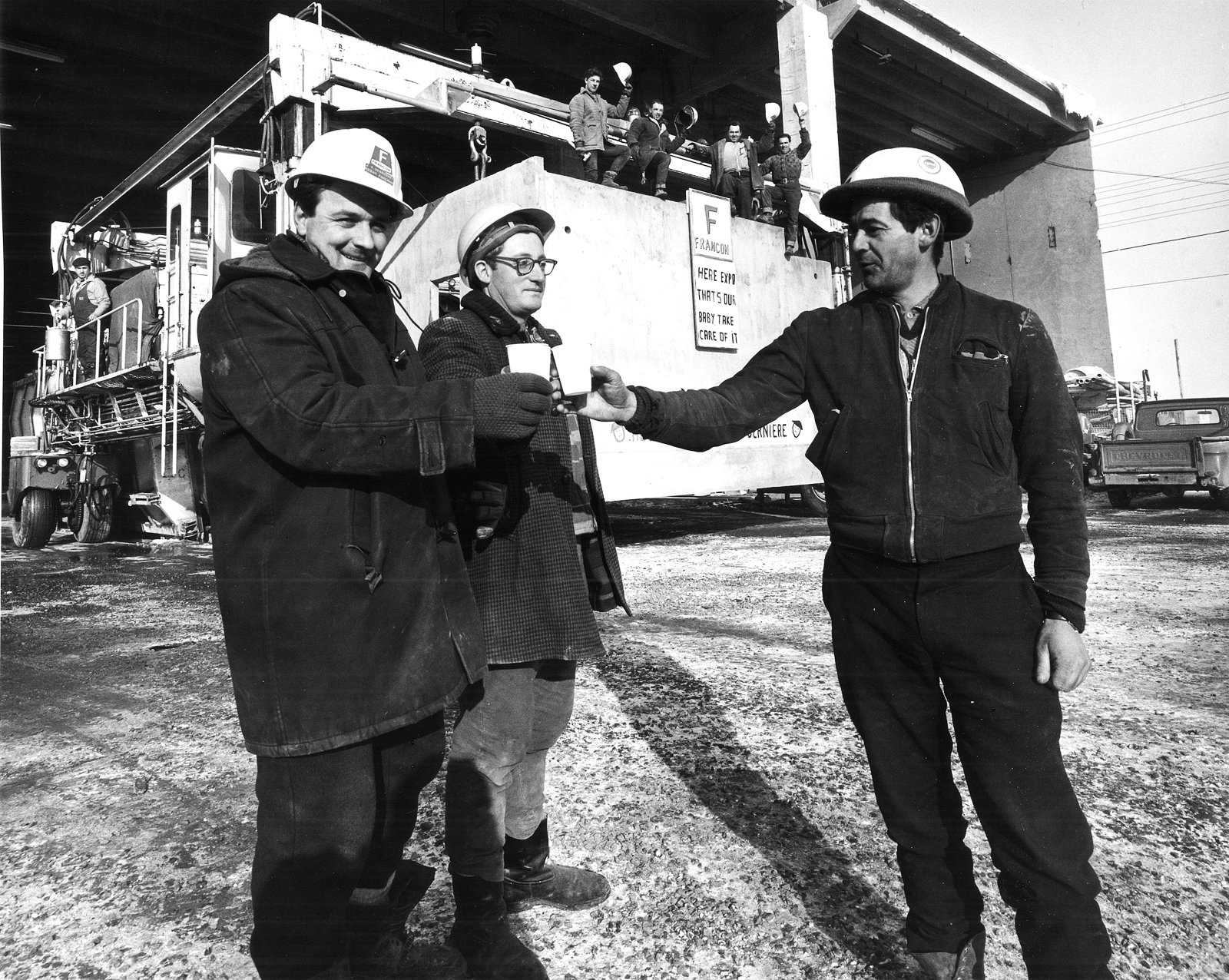 Builders toast the casting completion of the last box at Habitat '67 in Montreal, Quebec.  Photo 1 of 6 in A Look Back at Habitat '67 with Moshe Safdie